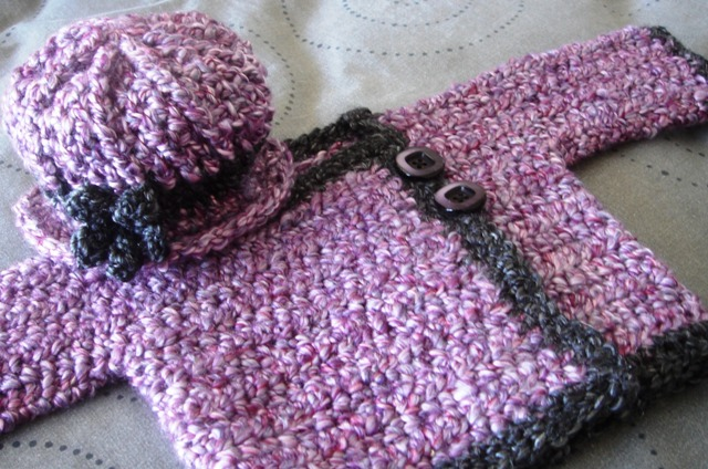 Derby_hat_and_baby_jacket